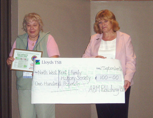 Joyce Hoad, Vice-President of NWKent FHS (left) receives the award and cheque from Sue Fearn, Editorial Manager of Family Tree Magazine